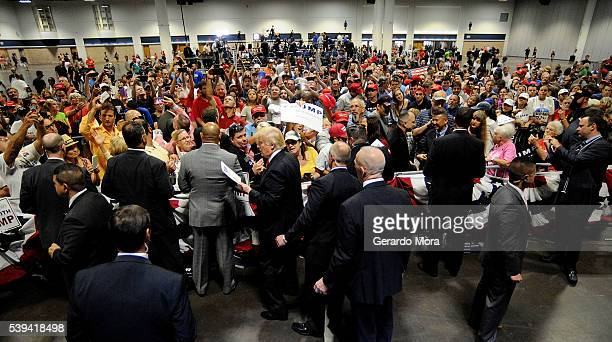 Republican presidential candidate Donald Trump greets supporters during a campaign rally at the Tampa Convention Center on June 11 2016 in Tampa...