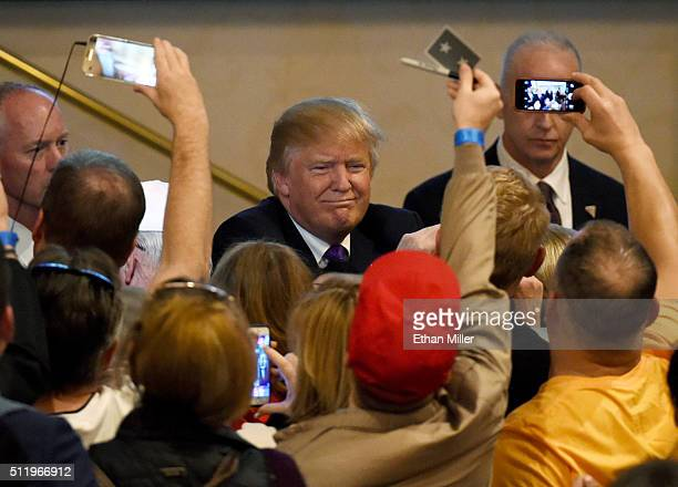 Republican presidential candidate Donald Trump greets supporters after speaking at a caucus night watch party at the Treasure Island Hotel Casino on...