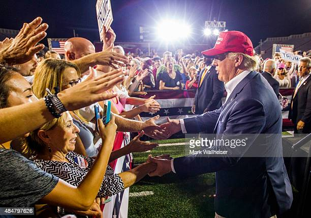 Republican presidential candidate Donald Trump greets supporters after his rally at LaddPeebles Stadium on August 21 2015 in Mobile Alabama The Trump...