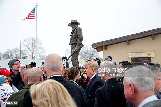 Republican presidential candidate Donald Trump greets supporters outside the John Wayne Birthplace Museum on January 19 2016 in Winterset Iowa Trump...
