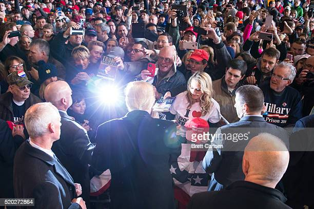 Republican presidential candidate Donald Trump greets the crowd at a rally for his campaign on April 10, 2016 in Rochester, New York. The New York...