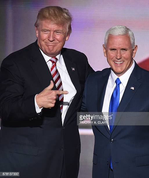 Republican presidential candidate Donald Trump greets vice presidential candidate Mike Pence after his speech on day three of the Republican National...