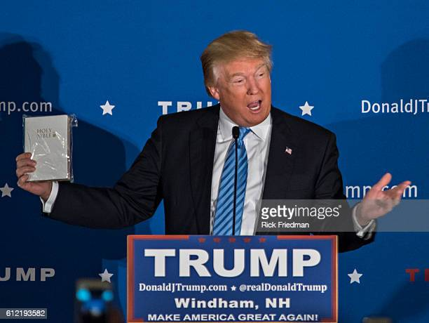 Republican Presidential candidate Donald Trump holding a bible given to him by a supporters at a campaign rally at The Castelton Banquet Conference...