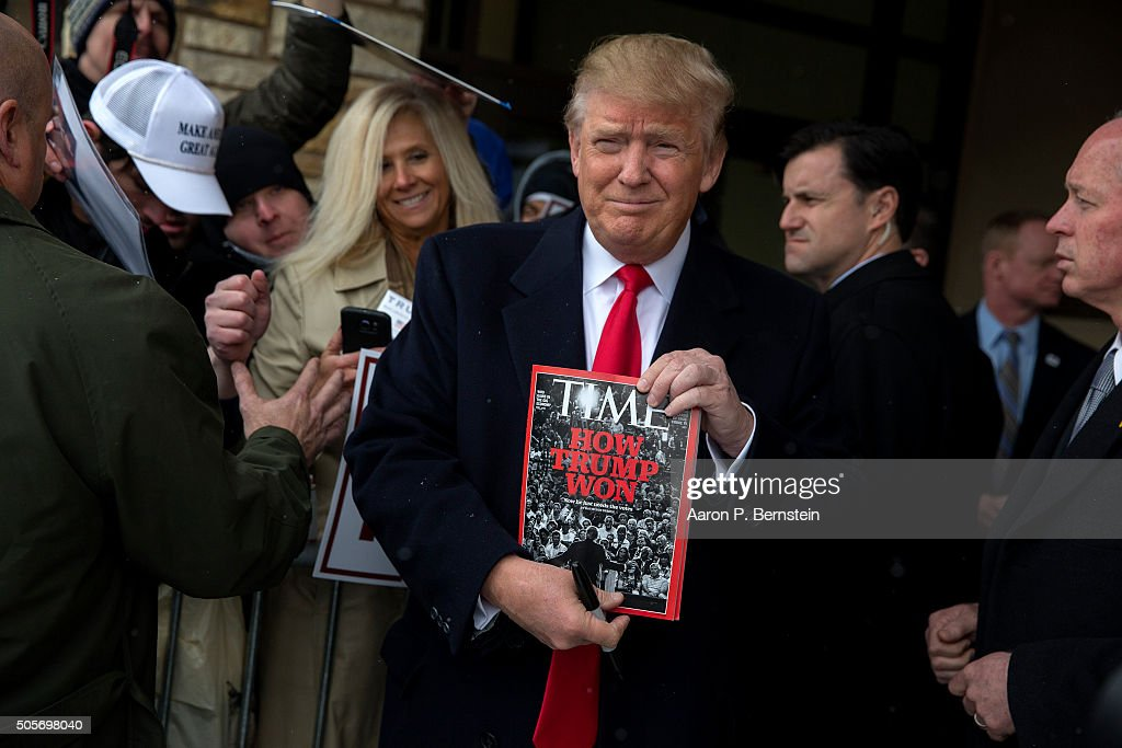 Republican presidential candidate Donald Trump holds a copy of Time Magazine outside the John Wayne Birthplace Museum on January 19, 2016 in Winterset, Iowa. Trump received the endorsement of Aissa Wayne, John Wayne's daughter.