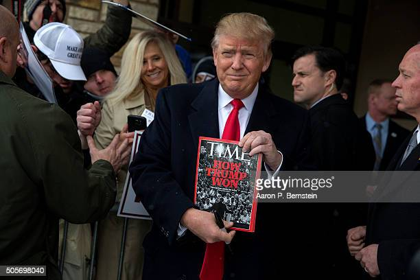Republican presidential candidate Donald Trump holds a copy of Time Magazine outside the John Wayne Birthplace Museum on January 19, 2016 in...