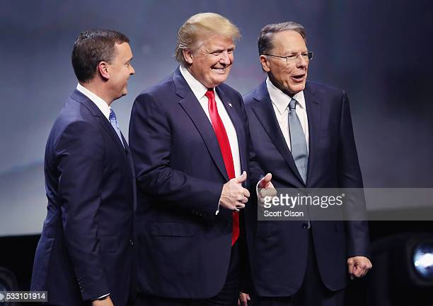 Republican presidential candidate Donald Trump is introduced with Chris Cox Executive Director of the NRA Institute for Legislative Action and Wayne...