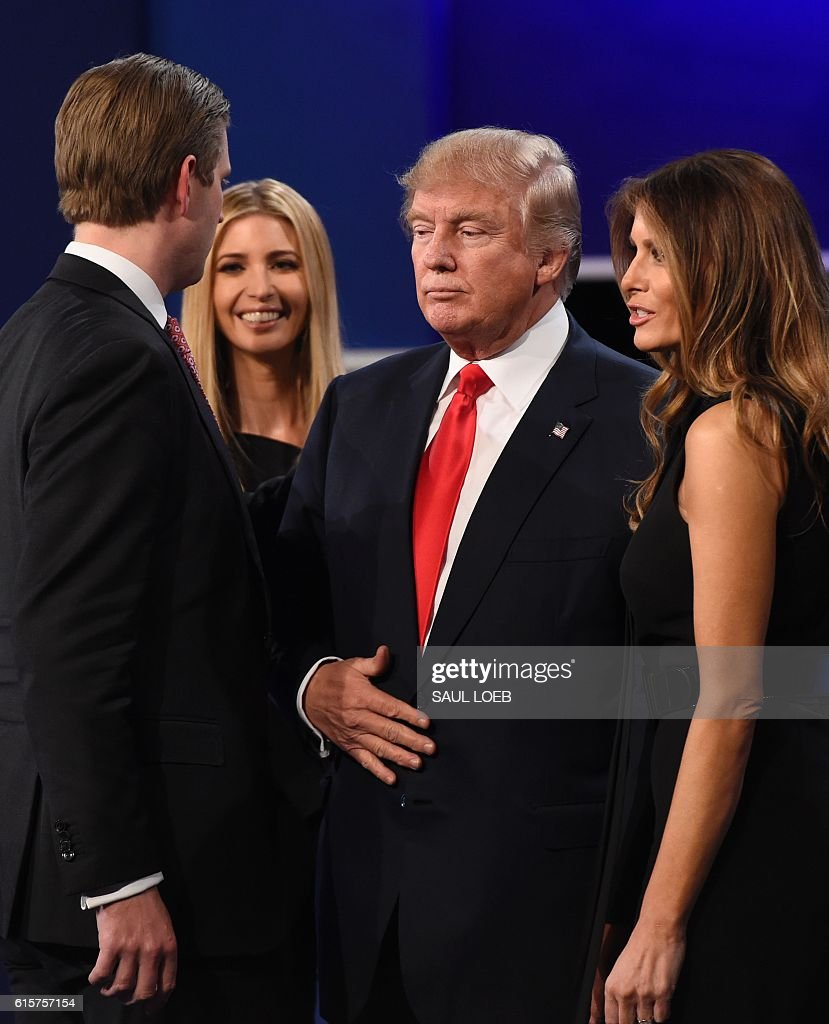 Republican presidential candidate Donald Trump is joined by his wife Melania (R), daughter Ivanka Trump (2nd L) and son Eric trump after the final presidential debate at the Thomas & Mack Center on the campus of the University of Las Vegas in Las Vegas, Nevada on October 19, 2016. / AFP / SAUL