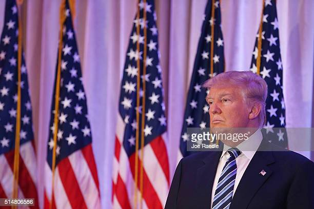 Republican presidential candidate Donald Trump is seen as former presidential candidate Ben Carson gives him his endorsement during a press...
