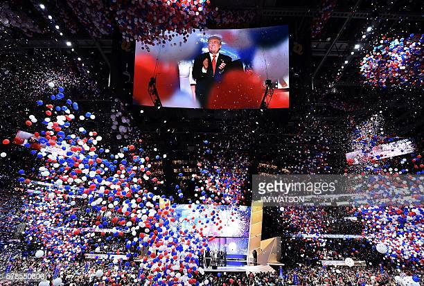 US Republican presidential candidate Donald Trump is seen onscreen at the closing of the Republican National Convention at the Quicken Loans Arena in...