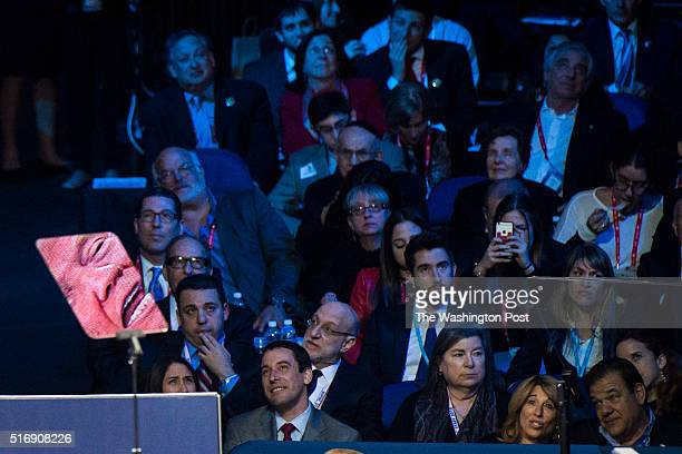 Republican presidential candidate Donald Trump is seen reflected in a teleprompter as he speaks during a campaign press conference at the at the...