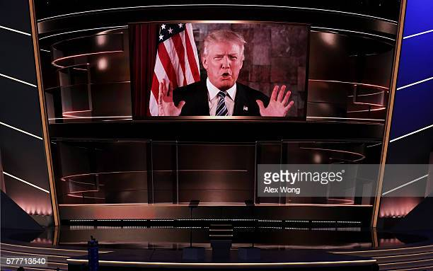 Republican presidential candidate Donald Trump is seen speaking on a screen from New York City on the second day of the Republican National...