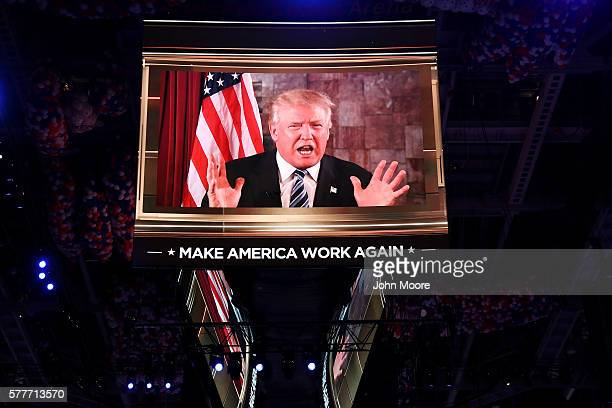 Republican presidential candidate Donald Trump is seen speaking on a screen from New York City, on the second day of the Republican National...