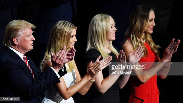 Republican presidential candidate Donald Trump, Ivanka Trump, Tiffany Trump and Lara Yunaska stand and cheer for Eric Trump as he delivers his speech...