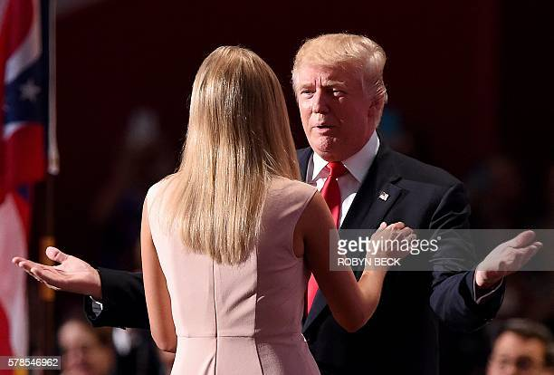 Republican presidential candidate Donald Trump kisses his daughter Ivanka Trump as he enters the stage on the last day of the Republican National...
