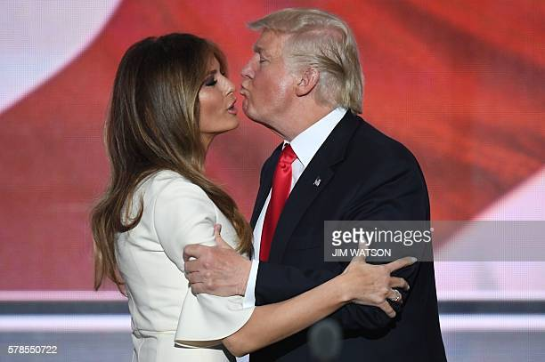 US Republican presidential candidate Donald Trump kisses his wife Melania on the final night of the Republican National Convention at the Quicken...