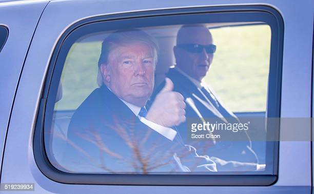Republican presidential candidate Donald Trump leaves a polling place at the Waukesha Fire Department where he met outside with voters and supporters...