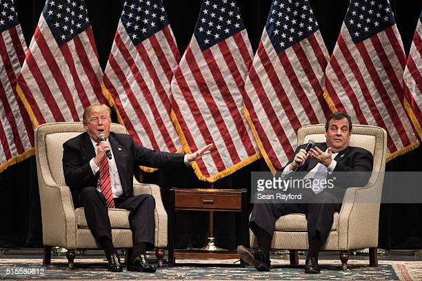 Republican presidential candidate Donald Trump, left, talks with New Jersey Gov. Chris Christie, right, during a campaign rally at Lenoir-Rhyne...
