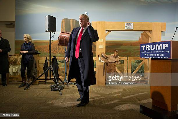 Republican presidential candidate Donald Trump listens to a question from a reporter at the John Wayne Birthplace Museum on January 19, 2016 in...