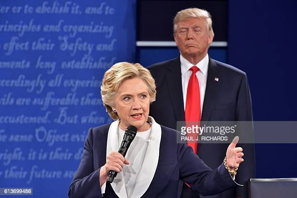 Republican presidential candidate Donald Trump listens to Democratic presidential candidate Hillary Clinton during the second presidential debate at...