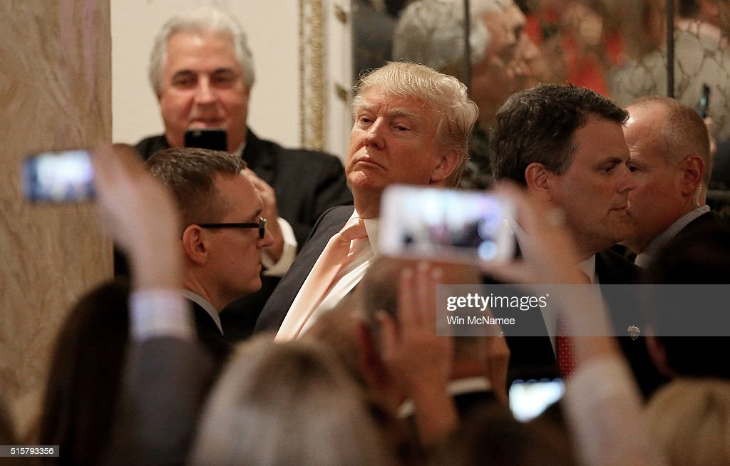 Republican presidential candidate Donald Trump looks at reporters shouting questions to him after he delivered remarks at primary night event at the Mar-A-Lago Club's Donald J. Trump Ballroom March 15, 2016 in Palm Beach, Florida. Trump won the state of Florida and Ohio Gov. John Kasich won the state of Ohio.