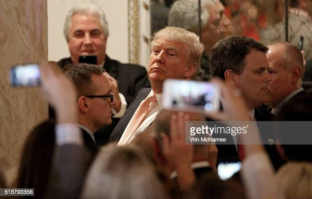 Republican presidential candidate Donald Trump looks at reporters shouting questions to him after he delivered remarks at primary night event at the...