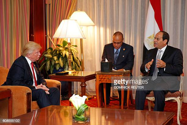 Republican presidential candidate Donald Trump looks on as Egyptian President Abdel Fattah elSisi speaks during a meeting at the Plaza Hotel on...