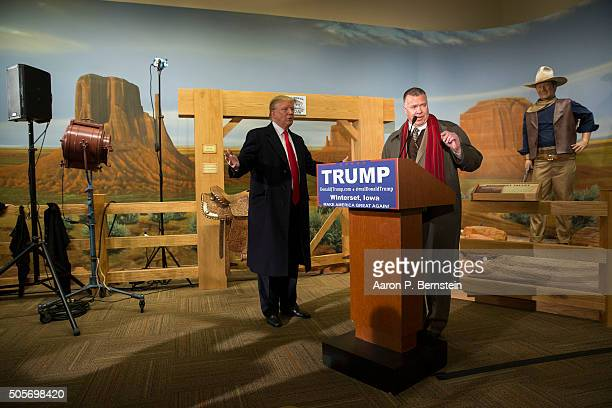 Republican presidential candidate Donald Trump looks on as Trump state director Chuck Laudner speaks at the John Wayne Birthplace Museum on January...