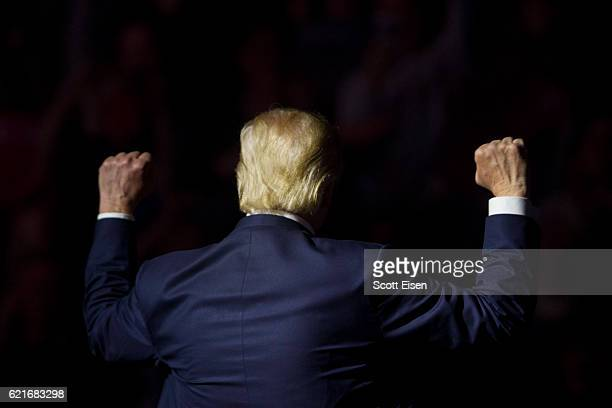 Republican presidential candidate Donald Trump makes gestures to supporters at the end of his rally at the SNHU Arena on November 7 2016 in...