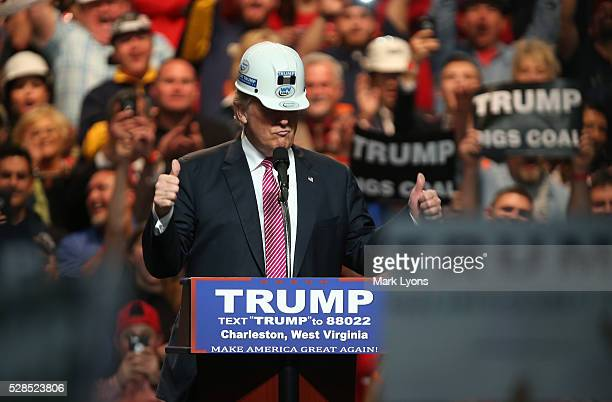 Republican Presidential candidate Donald Trump models a hard hat in support of the miners during his rally at the Charleston Civic Center on May 5...