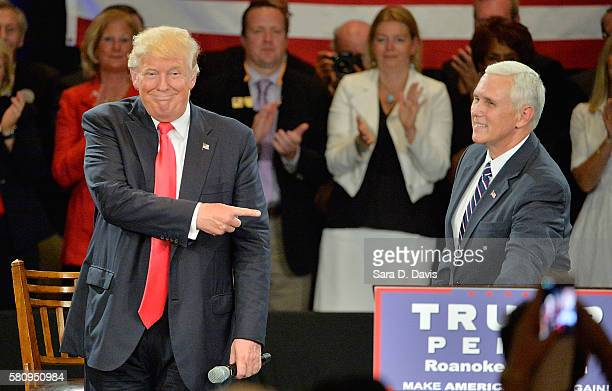 Republican presidential candidate Donald Trump motions to Republican vice presidential candidate Mike Pence at a campaign stop at address an audience...