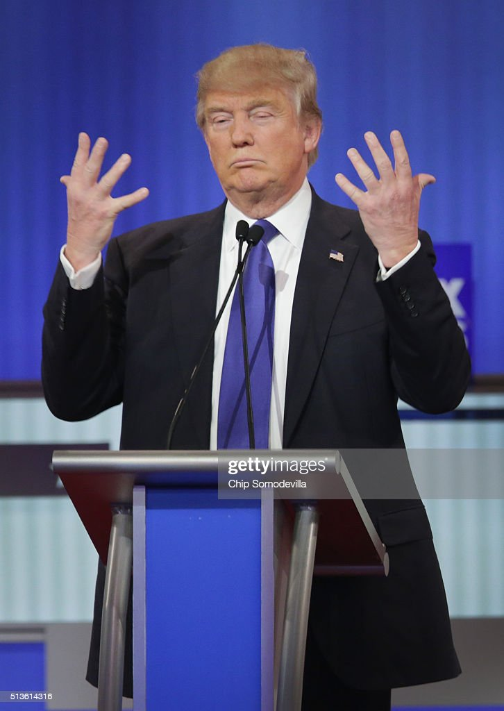 Republican presidential candidate Donald Trump participates in a debate sponsored by Fox News at the Fox Theatre on March 3, 2016 in Detroit, Michigan. Voters in Michigan will go to the polls March 8 for the State's primary.