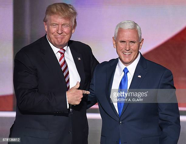 Republican presidential candidate Donald Trump points at vice presidential candidate Mike Pence at the end of the third day of the Republican...