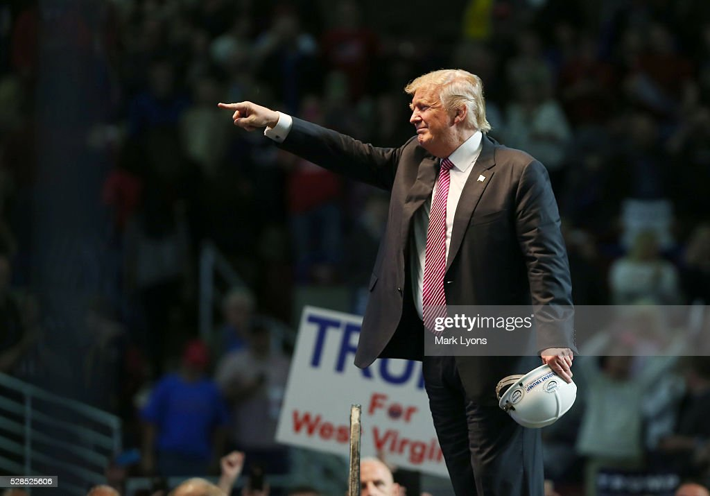 Republican Presidential candidate Donald Trump points to supporters following his speech at the Charleston Civic Center on May 5, 2016 in Charleston, West Virginia. Trump became the Republican presumptive nominee following his landslide win in indiana on Tuesday.