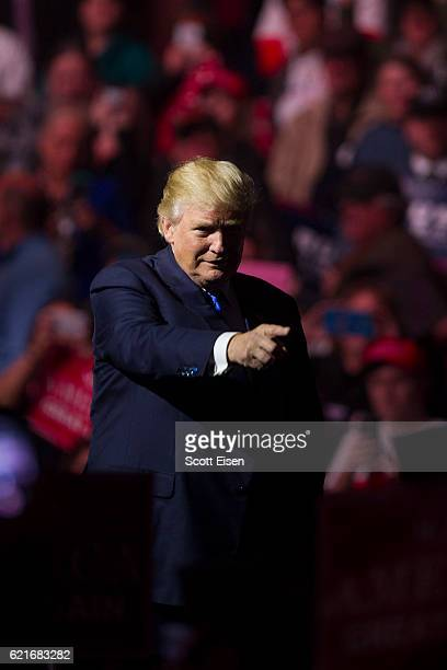 Republican presidential candidate Donald Trump points to supporters at the end of his rally at the SNHU Arena on November 7 2016 in Manchester New...