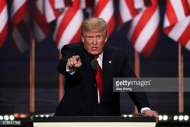 Republican presidential candidate Donald Trump points to the crowd as he delivers a speech during the evening session on the fourth day of the...