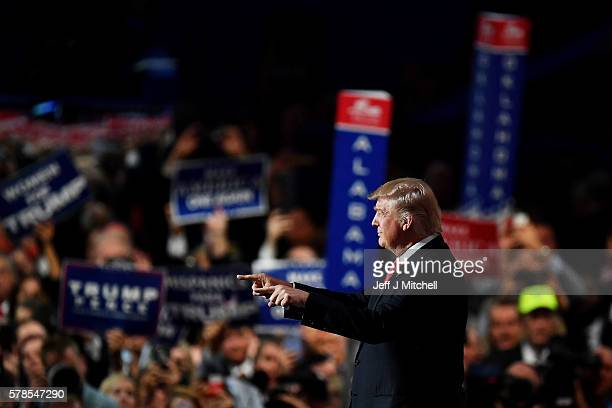 Republican presidential candidate Donald Trump points to the crowd during the evening session on the fourth day of the Republican National Convention...