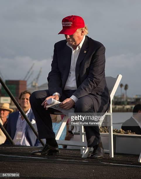 """Republican presidential candidate Donald Trump prepares to address the crowd during an appearance for """"Veterans For A Strong America"""" aboard the USS..."""