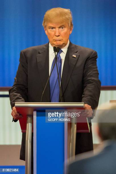 Republican Presidential candidate Donald Trump reacts to a question during the Republican Presidential Debate in Detroit Michigan March 3 2016 / AFP...