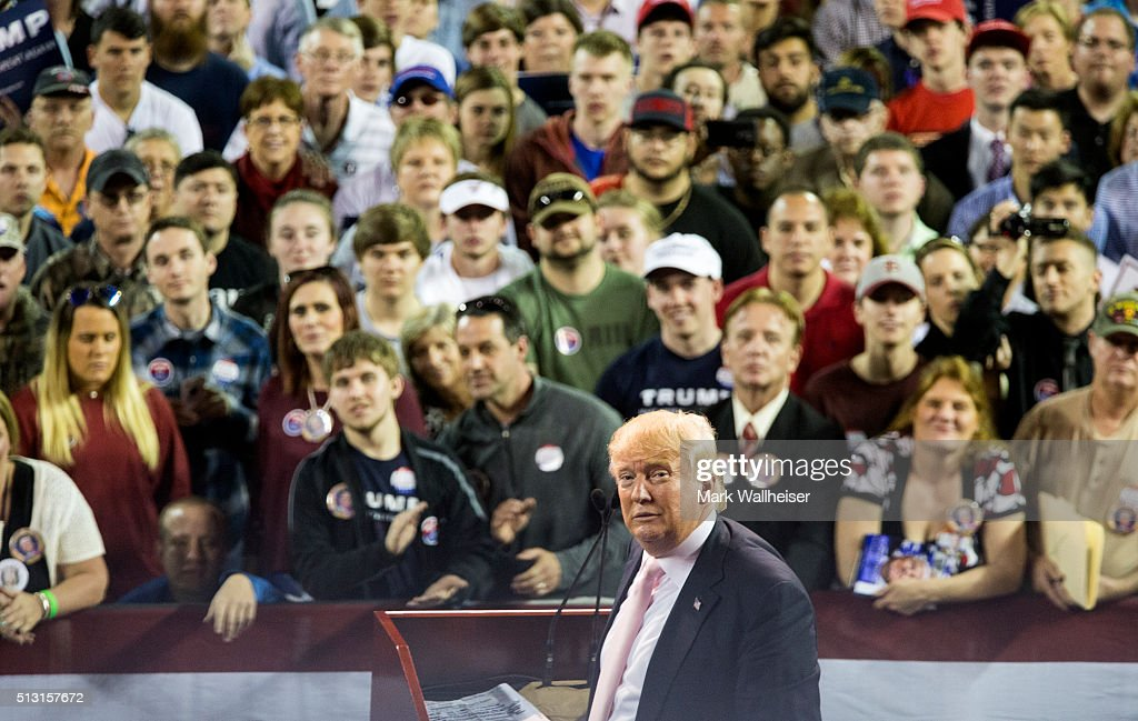 Republican presidential candidate Donald Trump reacts to supporters during a rally at Valdosta State University February 29, 2016 in Valdosta, Georgia. On the eve of the Super Tuesday primaries, Trump is enjoying his best national polling numbers of the election cycle, increasing his lead over rivals Sens. Marco Rubio (R-FL) and Ted Cruz (R-TX).
