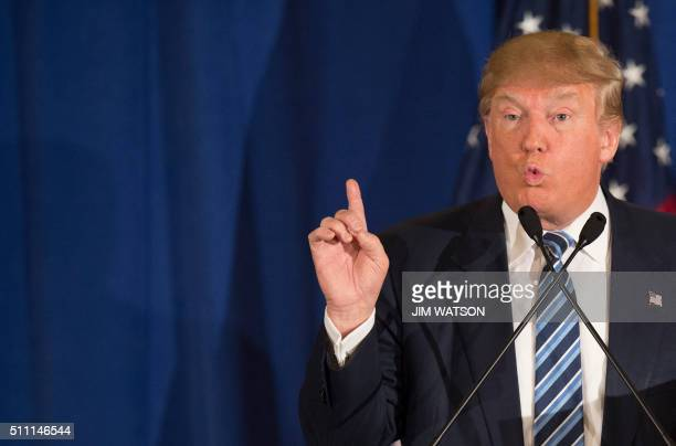 Republican presidential candidate Donald Trump reads from a statement about Pope Francis during a campaign rally in Kiawah South Carolina February 17...