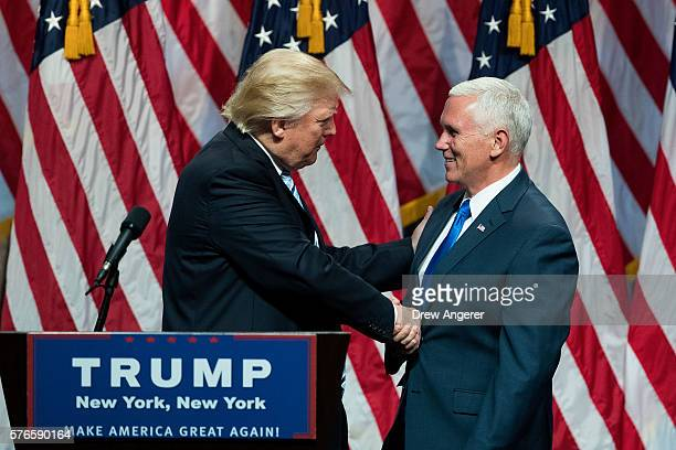 Republican presidential candidate Donald Trump shakes hands with his newly selected vice presidential running mate Mike Pence governor of Indiana...