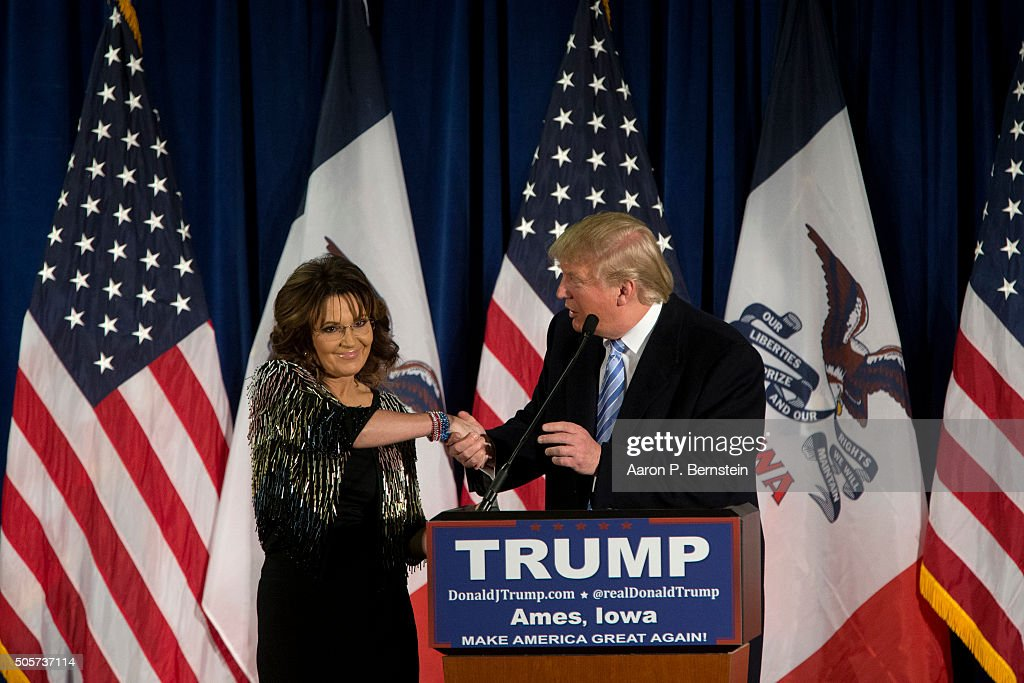 Republican presidential candidate Donald Trump shakes hands with former Alaska Gov. Sarah Palin at Hansen Agriculture Student Learning Center at Iowa State University on January 19, 2016 in Ames, IA. Trump received Palin's endorsement at the event.
