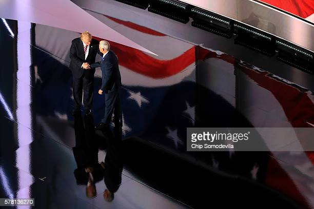 Republican presidential candidate Donald Trump shakes hands with Republican vice presidential candidate Mike Pence after he delivered a speech on the...