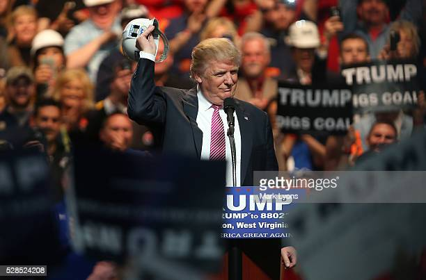 Republican Presidential candidate Donald Trump shos off a hard hat during hie rally at the Charleston Civic Center on May 5 2016 in Charleston West...