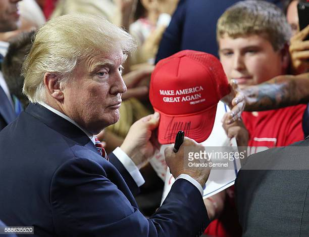 Republican presidential candidate Donald Trump signs autographs during a campaign rally at Silver Spurs Arena in Kissimmee Fla on Thursday Aug 11 2016