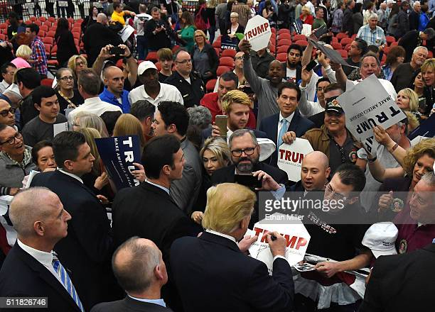 Republican presidential candidate Donald Trump signs autographs after speaking at a rally at the South Point Hotel Casino on February 22 2016 in Las...