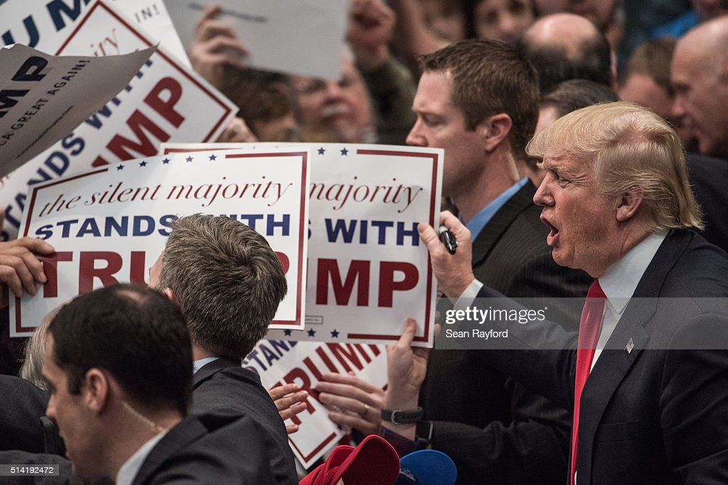 Republican presidential candidate Donald Trump signs autographs at a campaign rally March 7, 2016 in Concord, North Carolina. The North Carolina Republican presidential primary will be held March 15.