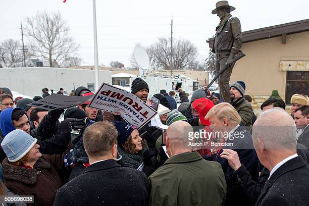 Republican presidential candidate Donald Trump signs autographs for supporters outside the John Wayne Birthplace Museum on January 19 2016 in...