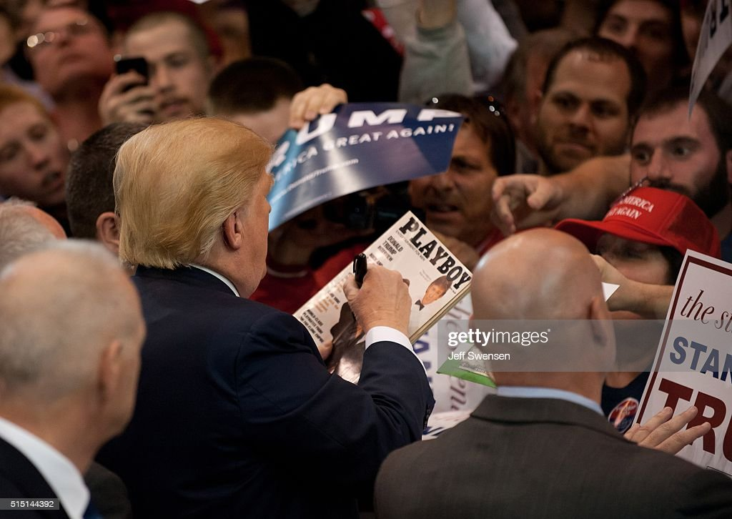 Republican presidential candidate Donald Trump signs autographs for guests gathered for a campaign event at the I-X Center March 12, 2016 in Cleveland, Ohio.