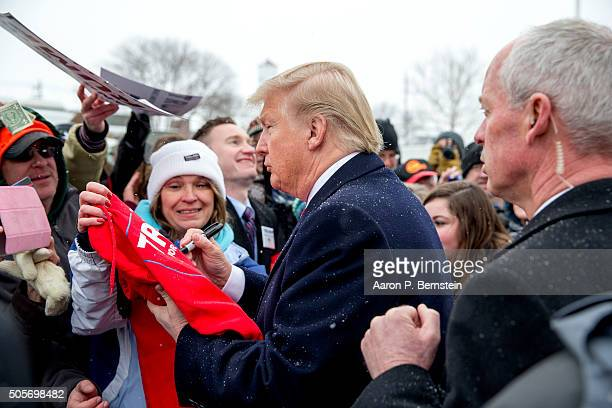 Republican presidential candidate Donald Trump signs autographs outside the John Wayne Birthplace Museum on January 19, 2016 in Winterset, Iowa....